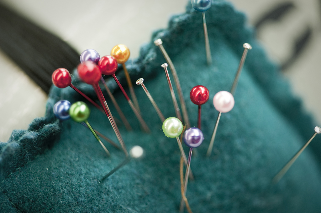 Close up of Pins in a pin cussion, Photographed at the University of Derby, ADT fashion department.